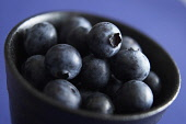 Blueberry, Vaccinium corymbosum, Black coloured fruit in a bowl.