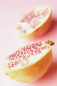 Pomegranate, Punica granatum, Pink subject, Pink background.