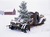 Christmas decorations on old truck with snow, Oregon, USA.